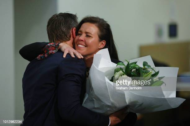 Melbourne Storm Head Coach Craig Bellamy presents Nicole Slater with flowers during a Melbourne Storm NRL media opportunity at AAMI Park on August 8...