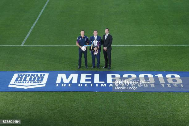 Melbourne Storm Head Coach Craig Bellamy Sports Minister John Eren MP and Storm CEO Dave Donaghy pose with the World Club Challenge Trophy during a...