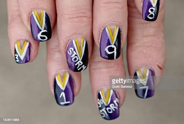 Melbourne Storm NRL supporter Alice Homer displays her painted fingernails during NRL Grand Final Week in Melbourne on September 27 2012 in Melbourne...