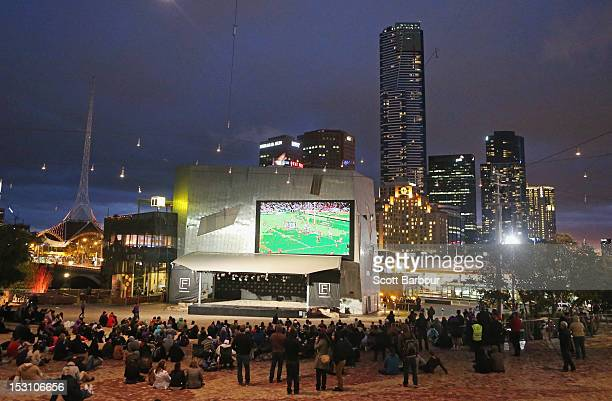 Melbourne Storm NRL supporters watch a large screen showing the 2012 NRL Grand Final match between the Melbourne Storm and the Canterbury Bulldogs...