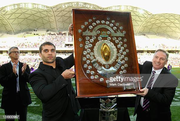 Melbourne Storm player Maurice Blair and Club CEO Ron Gauci hold aloft the J J Giltenan Shield received by the club for winning the minor premiership...