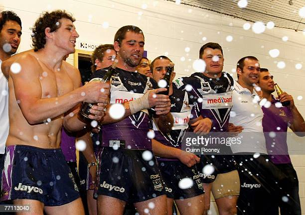 Melbourne Storm players Billy Slater and Cameron Smith spray champagne in the rooms after winning the NRL Grand Final match between the Melbourne...