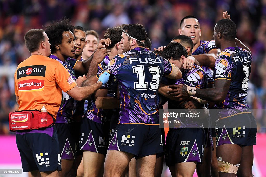Melbourne Storm players celebrate a Cameron Munster try during the round ten NRL match between the Melbourne Storm and the Gold Coast Titans at Suncorp Stadium on May 12, 2018 in Brisbane, Australia.