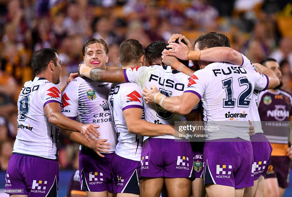 Melbourne Storm players celebrate a try by Billy Slater of the Storm during the round seven NRL match between the Brisbane Broncos and the Melbourne Storm at Suncorp Stadium on April 20, 2018 in Brisbane, Australia.