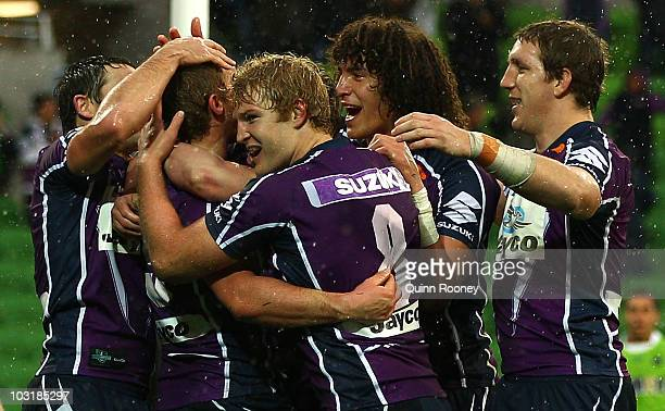 Melbourne Storm players celebrate a try during the round 21 NRL match between the Melbourne Storm and the Canberra Raiders at AAMI Park on August 1...