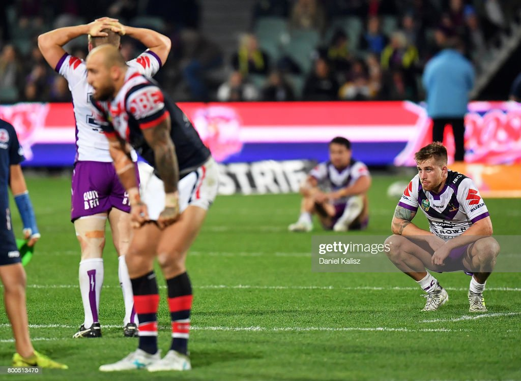 Melbourne Storm players look on dejected after the final whistle during the round 16 NRL match between the Sydney Roosters and the Melbourne Storm at Adelaide Oval on June 24, 2017 in Adelaide, Australia.