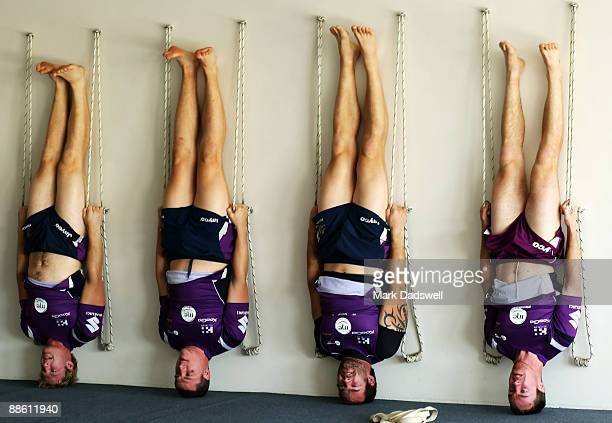 Melbourne Storm players perform a yoga exercise during a Melbourne Storm NRL recovery session at Bridge Road Yoga Studios on June 22 2009 in...