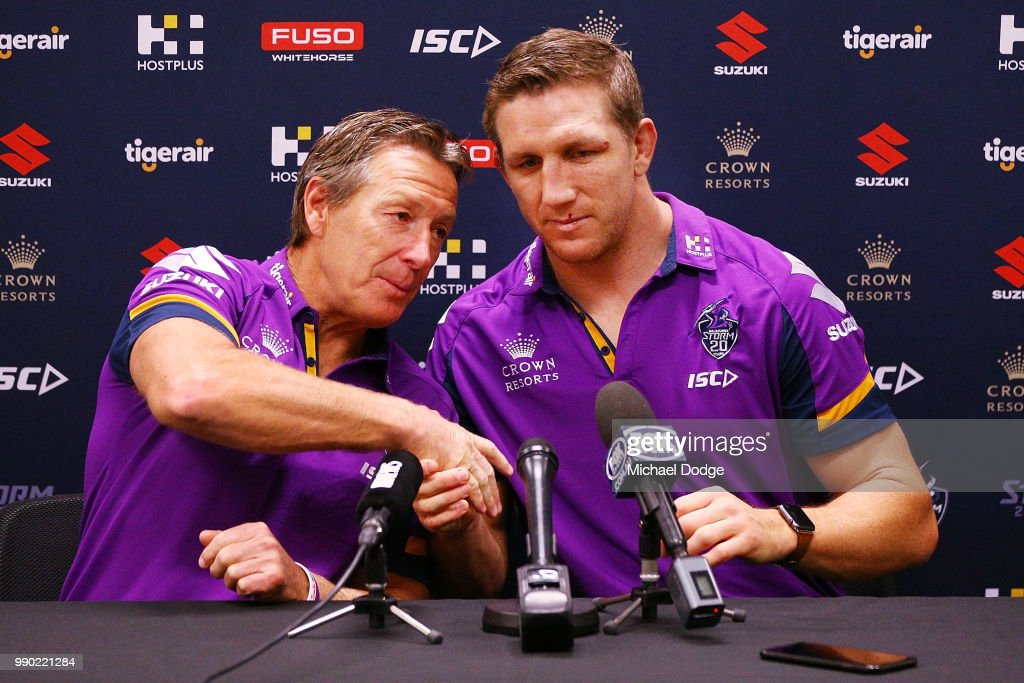 Melbourne Storm veteran Ryan Hoffman and head coach Craig Bellamy shake hands during a press conference to announce his retirement on July 3, 2018 in Melbourne, Australia. Hoffman will take up an administrative role with the Storm after confirming he will retire at the end of the NRL season.