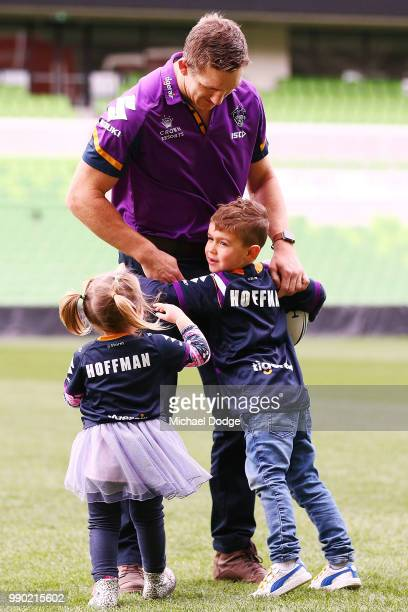 Melbourne Storm veteran Ryan Hoffman plays with his children Mia and Zach during a press conference to announcement his retirement on July 3 2018 in...