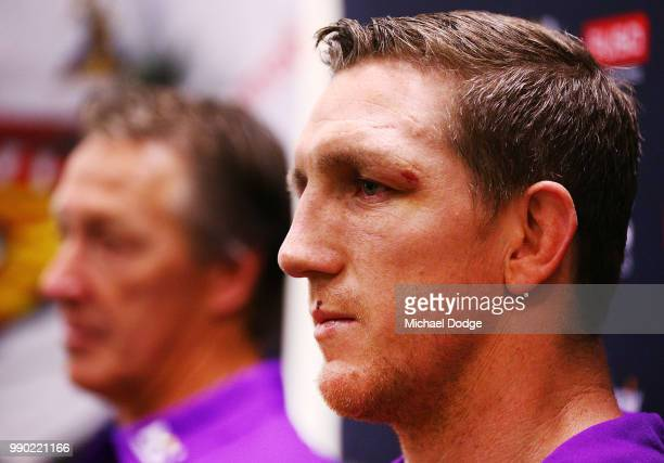 Melbourne Storm veteran Ryan Hoffman speaks to media next to head coach Craig Bellamy during a press conference to announce his retirement on July 3...
