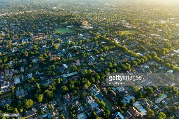 melbourne suburb in the sunrise - aerial view stock pictures, royalty-free photos & images