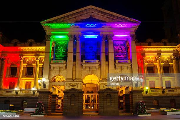 melbourne town hall, lit in rainbow colours - transexual stock photos and pictures