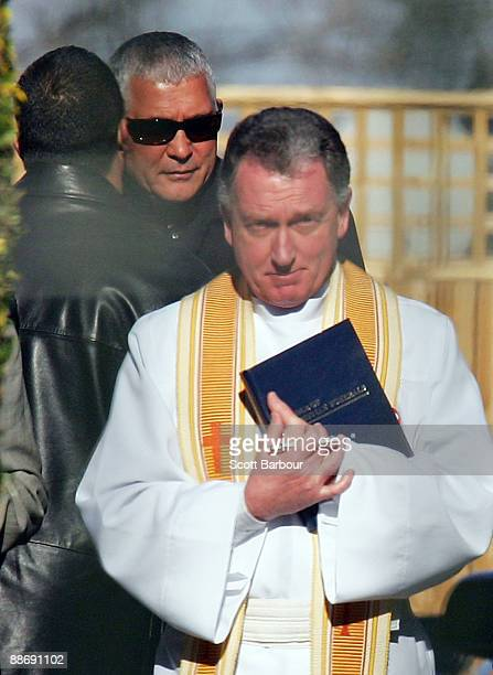 Melbourne underworld figure Mick Gatto watches as the coffin of Desmond Moran is placed in a hearse at the funeral of underworld figure Desmond...