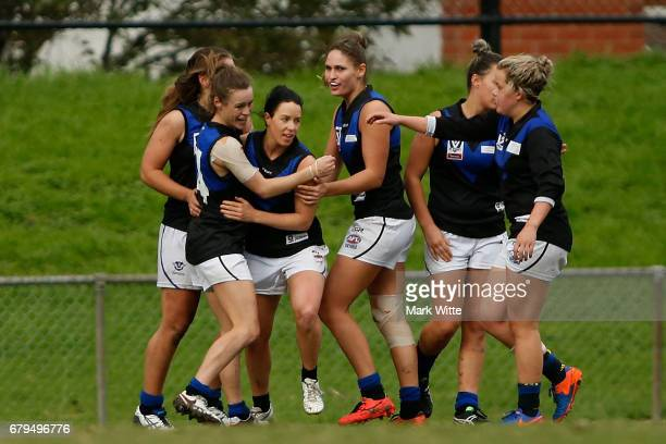 Melbourne Uni celebrate one of there goals during the round one VFL Women's match between the Darebin Falcons and Melbourne Uni at Bill Lawry on May...