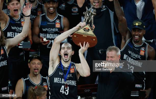 Melbourne United captain Chris Goulding and coach Dean Vickerman celebrate as they are presented with the trophy after winning game five of the NBL...