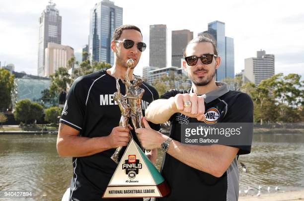 Melbourne United captain Chris Goulding and Josh Boone pose with the trophy after winning the NBL Grand Championship during a Melbourne United media...