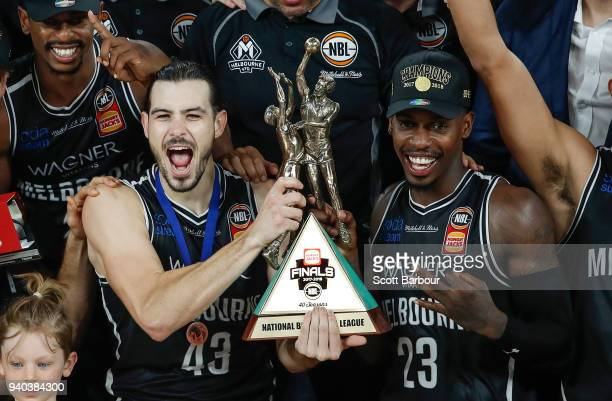 Melbourne United captain Chris Goulding Casey Prather of Melbourne United and their teammates celebrate as they are presented with the trophy after...