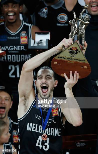 Melbourne United captain Chris Goulding celebrates as they are presented with the trophy after winning game five of the NBL Grand Final series...