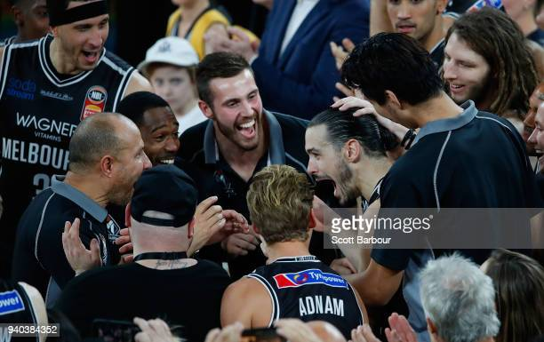 Melbourne United captain Chris Goulding is congratulated by his teammates as he is announced as the winner of the Larry Sengstock Medallist as grand...
