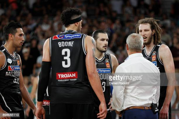 Melbourne United head coach Dean Vickerman addresses his team with 05 on the clock of the 4th quarter during the round 12 NBL match between Melbourne...