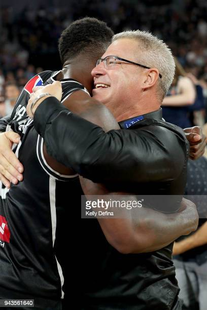 Melbourne United head coach Dean Vickerman and Casey Prather of Melbourne United celebrate the victory of game five of the NBL Grand Final series...