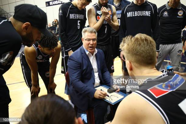 Melbourne United head coach Dean Vickerman talks to his players during the NBL preseason match between Melbourne United and the Sydney Kings at State...