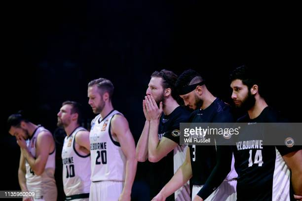 Melbourne United players observe a minute's silence for the victims of the Mosque shooting in Christchurch New Zealand during game three of the NBL...