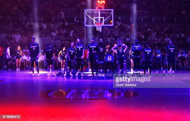 Melbourne United stand for the national anthem during the round 19 NBL match between Melbourne United and the Illawarra Hawks at Hisense Arena on...