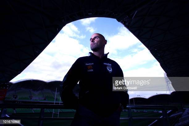 Melbourne Victory captain Kevin Muscat poses for photographs after announcing he has signed on for another season during a press conference at AAMI...