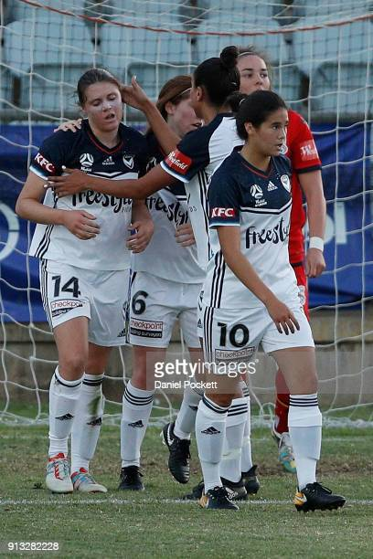 Melbourne Victory celebrate a goal to Kyra CooneyCross of Melbourne Victory during the round 14 WLeague match between Adelaide United and the...