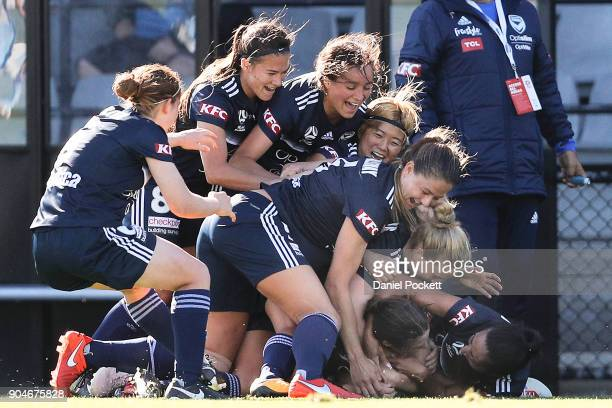 Melbourne Victory celebrate a goal to Melina Ayres of Melbourne Victory during the round 11 WLeague match between the Melbourne Victory and Melbourne...