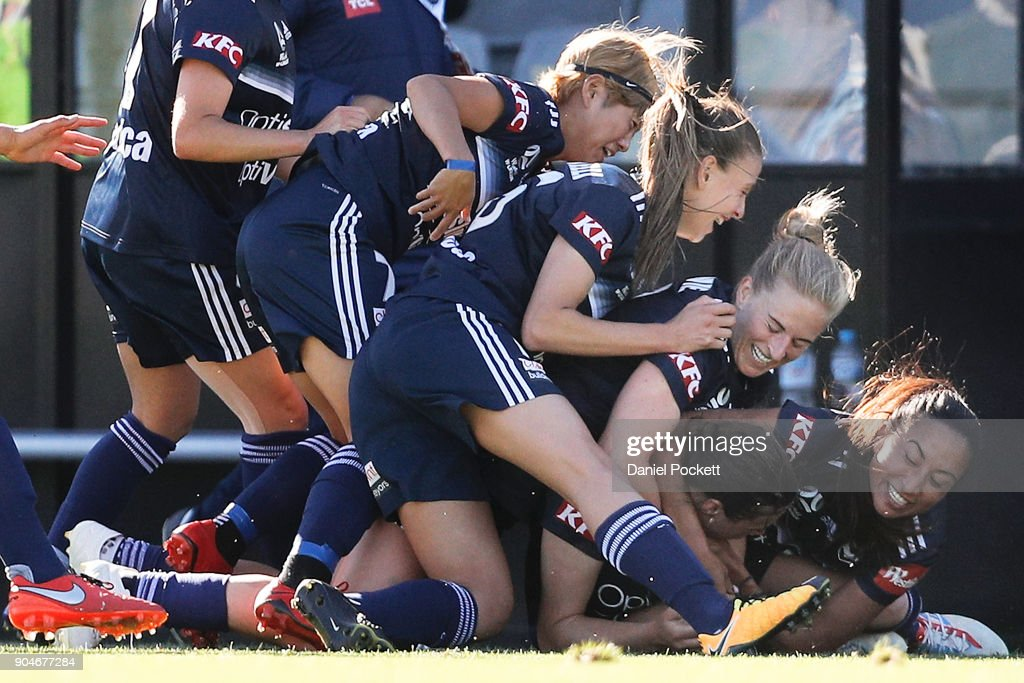 Melbourne Victory celebrate a goal to Melina Ayres of Melbourne Victory during the round 11 W-League match between the Melbourne Victory and Melbourne City at Epping Stadium on January 14, 2018 in Melbourne, Australia.