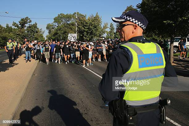 Melbourne Victory fans followed by police on horseback arrive down City Rd for the round 19 ALeague match between Melbourne City FC and Melbourne...