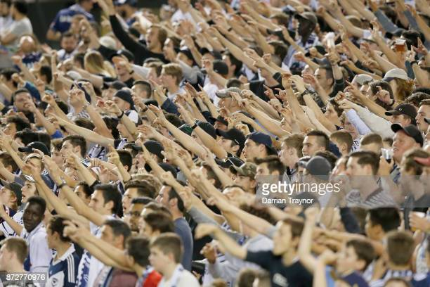 Melbourne Victory fans support their team during the round six ALeague match between the Melbourne Victory and Brisbane Roar at Etihad Stadium on...
