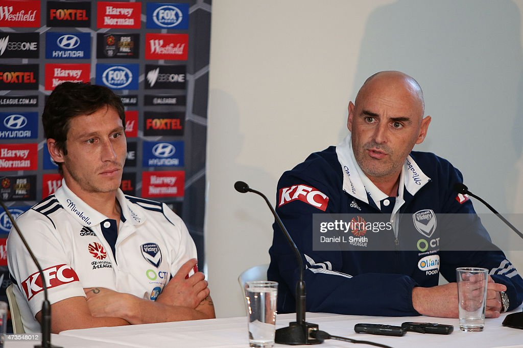 Melbourne Victory Head Coach, Kevin Muscat and Captain Mark Milligan speaks to the media during the A-League Grand Final press conference at Federation Square on May 16, 2015 in Melbourne, Australia.