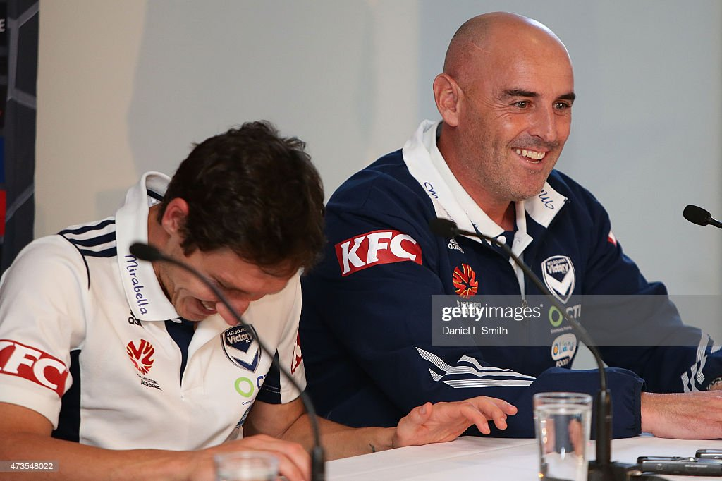 Melbourne Victory Head Coach, Kevin Muscat and Captain Mark Milligan react to a joke during the A-League Grand Final press conference at Federation Square on May 16, 2015 in Melbourne, Australia.