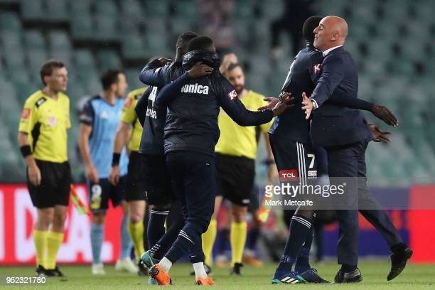 Melbourne Victory head coach Kevin Muscat celebrates victory with players during the ALeague Semi Final match between Sydney FC and Melbourne Victory...