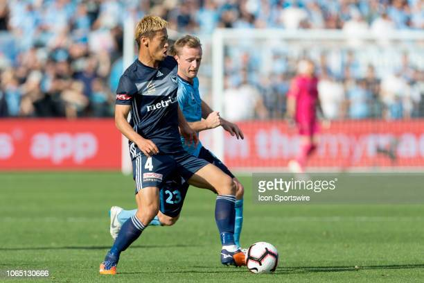 Melbourne Victory midfielder Keisuke Honda shields the ball from Sydney FC defender Rhyan Grant at the Hyundai ALeague Round 5 soccer match between...