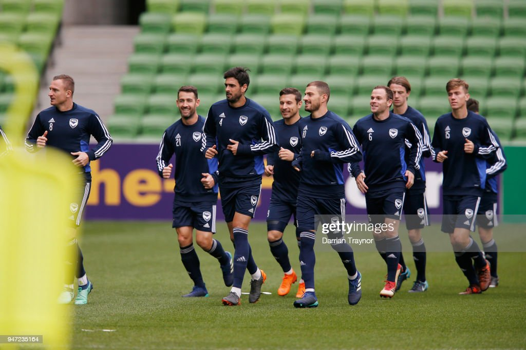 Melbourne Victory playerds warm up before a Melbourne Victory training session at AAMI Park on April 17, 2018 in Melbourne, Australia.