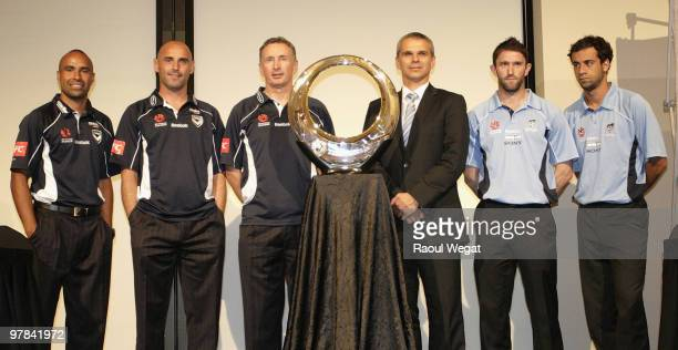 Melbourne Victory players Archie Thompson captain Kevin Muscat and coach Ernie Merrick Sydney FC coach Vitezslav Lavicka Terry McFlynn and Alex...
