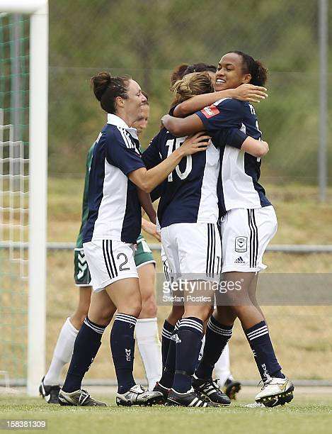 Melbourne Victory players celebrate a goal by Amy Jackson during the round nine W-League match between Canberra United and the Melbourne Victory at...