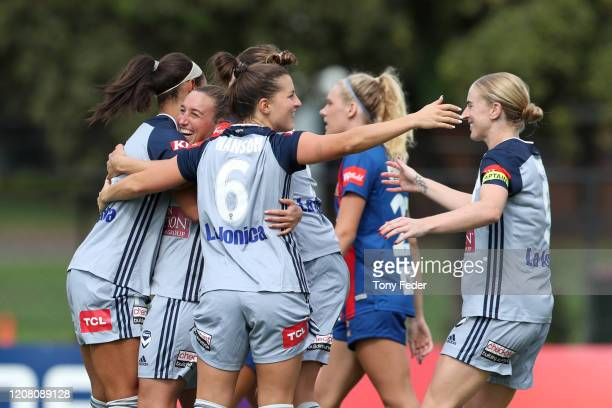 Melbourne Victory players celebrate a goal during the round 13 WLeague match between the Newcastle Jets and the Melbourne Victory at No2 Sportsground...