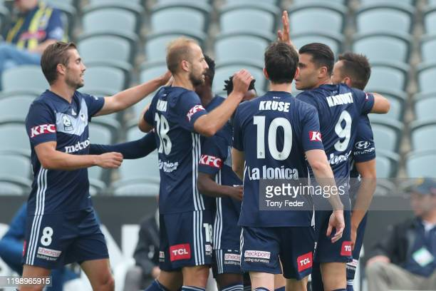 Melbourne Victory players celebrate a goal during the round 14 A-League match between the Central Coast Mariners and the Melbourne Victory at Central...