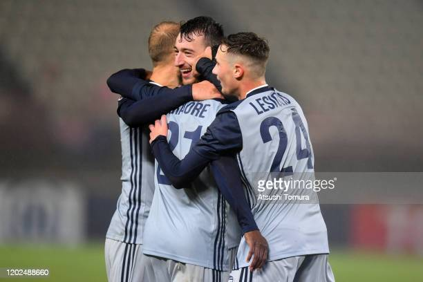 Melbourne Victory players celebrate their victory in the AFC Champions League playoff between Kashima Antlers and Melbourne Victory at Kashima Soccer...