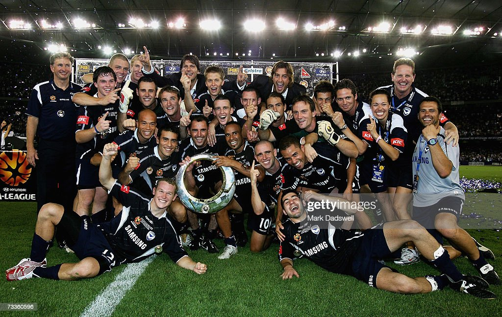 Melbourne Victory players celebrate with the trophy after winning the Hyundai A-League Grand Final between the Melbourne Victory and Adelaide United at the Telstra Dome February 18, 2007 in Melbourne, Australia.