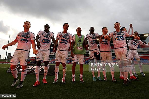 Melbourne Victory team celebrate after the win during the round 13 ALeague match between the Newcastle Jets and Melbourne Victory at Hunter Stadium...