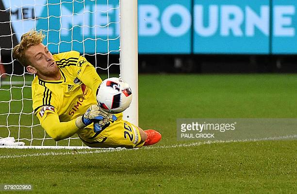 Melbourne Victory's goalkeeper Lawrence Thomas attempts to make a save in the penalty shootout during the International Champions Cup football match...