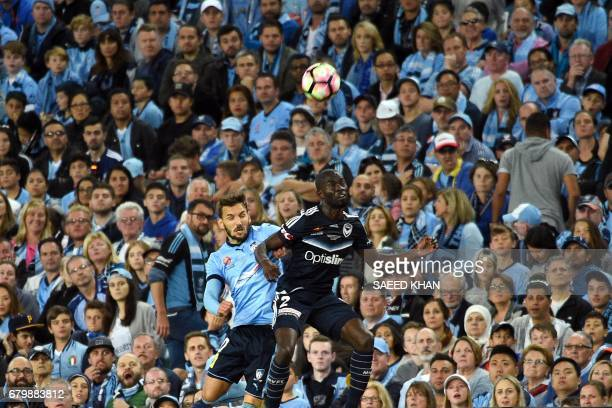 Melbourne Victory's Jason Geria fights for the ball with Sydney FC's Milos Ninkovic during the 2017 ALeague Grand Final match at Allianz Stadium in...