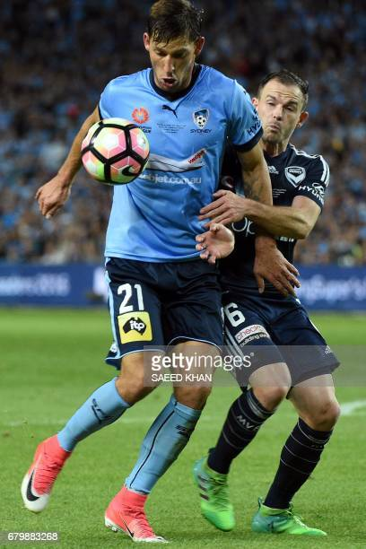 Melbourne Victory's Leigh Broxham fights for the ball with Sydney FC's Filip Holosko during the 2017 ALeague Grand Final match at Allianz Stadium in...