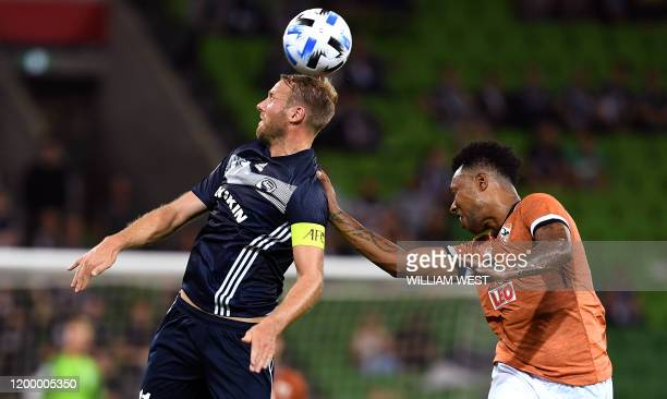 Melbourne Victory's Ola Toivonen heads the ball next to Chiangrai United's Brinner Henrique Souza during their AFC Champions League football match in...